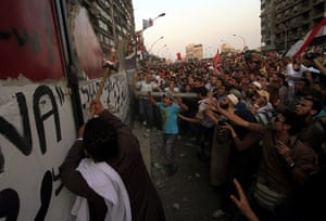 Egypt Riots: Egyptians demolish a concrete wall of the Israeli Embassy in Cairo