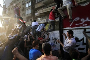 Egypt Riots: Egyptian activists demolish a wall built at the Israeli embassy in Cairo
