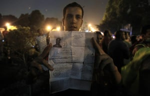 Egypt Riots: An Egyptian protester holds documents from the Israeli embassy in Cairo