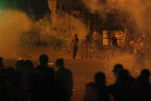 Egypt Riots: Protesters throw stones as tear gas is seen around them in Cairo
