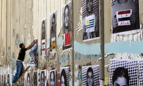 Palestinian portraits on the West Bank barrier