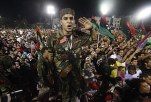 Tripoli celebration rally: An anti-Gaddafi fighter attends the celebration rally