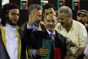 Tripoli celebration rally: Mustafa Abdel Jalil waves to supporters