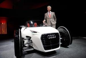 Frankfurt motor show: Rupert Stadler, chairman of the Audi AG poses next to the urban concept car