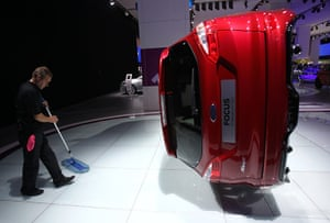 Frankfurt motor show: A worker cleans the stand of car manufacturer Ford during preparation work