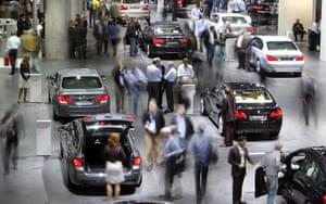 Frankfurt motor show: People walk between BMW cars on media day