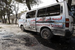 Kabul embassy attacks: A damaged vehicle is seen after a rocket-propelled grenade attack in Kabul