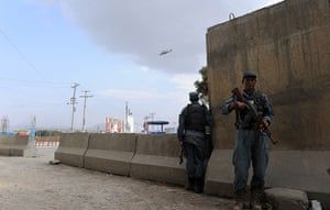 Kabul embassy attacks: Afghan police take cover as a helicopter flies over the area