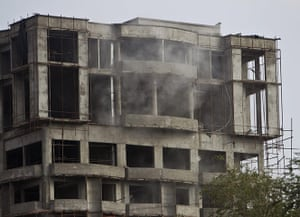 Kabul embassy attacks: Dust and smoke billows from the building