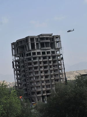 Kabul embassy attacks: A NATO helicopter flies over the building where Taliban fighters are hiding
