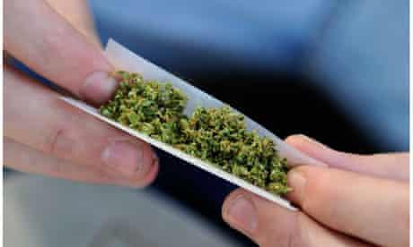 A young man prepares to smoke marijuana