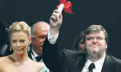 Michael Moore celebrates after winning the Palme d'Or for Fahrenheit 9/11