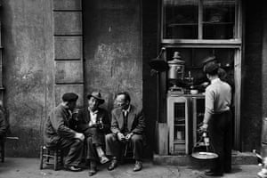 Vintage Istanbul: 1958, People sitting talking beside a coffee bar in a Beyoglu arcade