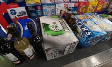 Bottles and crates of alcohol on a supermarket checkout
