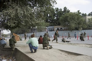 kabul seige: Afghan military personnel take cover during the seige