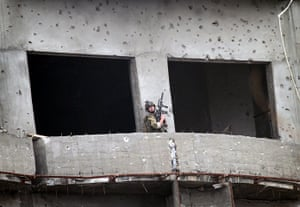 kabul seige: A coalition soldier moves around the building during the seige