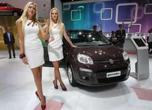 Frankfurt motor show: Fair hostesses pose next to a Fiat Panda car
