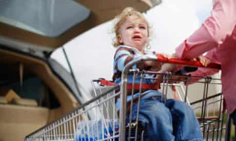 Child sat in shopping troley