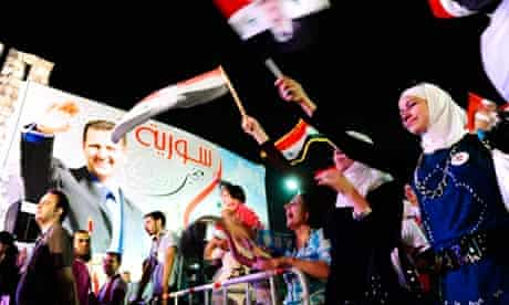 Supporters of Syrian President Bashar al-Assad celebrate his birthday in Damascus