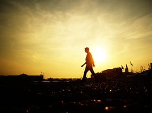 Weekend Readers' pictures: sillhouette of a person on brighton beach by James Wills