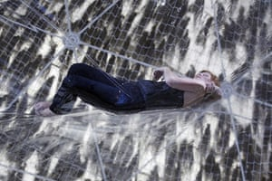 24 hours in pictures: Berlin, Germany: A woman lies in an installation
