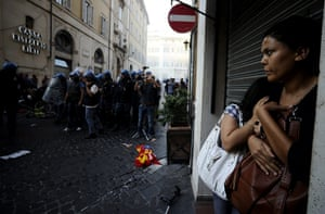 24 hours in pictures: Rome, Italy: Riot policemen clash with protesters