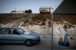 24 hours in pictures: Hvat Gilad, West Bank: A boy plays outside his home