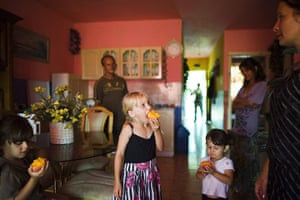FTA: Attila Balazs: The children of a day-worker couple eat fruit in their home
