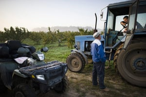 FTA: Attila Balazs: Farm-owner Bela Szakacs briefs one of his drivers about the day's work