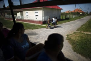 FTA: Attila Balazs: Day-workers look out of their bus as they arrive back home in Tiszavasvari