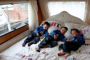 Dale Farm: Triplets John 'Button', David and Richard Sheridan asleep in their trailer