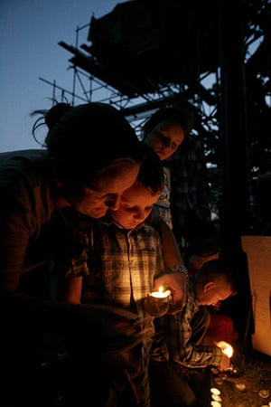 Dale Farm: Mary Quilligan and her son Pat light candles before saying the rosary