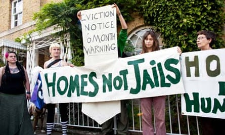 People protest for squatters rights on the roof of the Ken Clarke's house