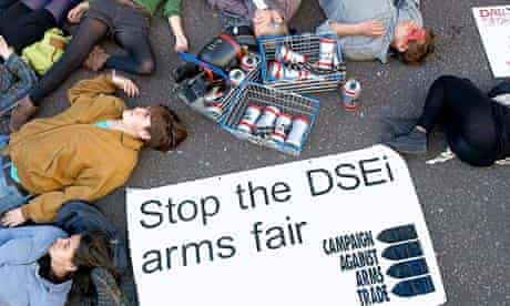 Protesters against the Defence and Security Equipment International fair