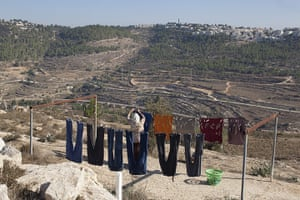 Levene West Bank: A woman hangs out clothes to dry at Al Walaja in the West Bank