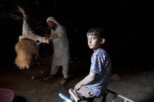 Levene West Bank: Mohammed, 38, from Al Fakheet, slaughters a goat as his son watches