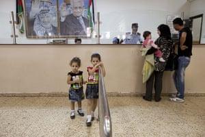 Levene West Bank: Noor Al Aqra, 25, has her passport checked at the  Istarha border crossing
