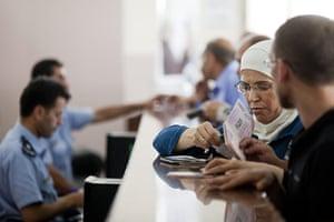 Levene West Bank: Passport checks at Istarha border crossing Palestinian checkpoint, Jericho