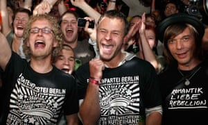 Supporters of the Pirate party celebrate after the first exit polls of the Berlin state election.