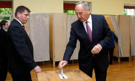 Latvia's President Berzins casts his vote during the snap parliament elections in Riga