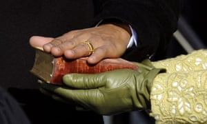 Barack Obama's hand lies on a bible as he is sworn in as US president