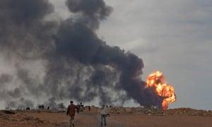 libya oil refinery burning