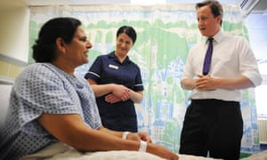 David Cameron meets a patient at Ealing Hospital in west London