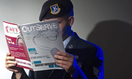 A gay member of the US air force reads a copy of OutServe