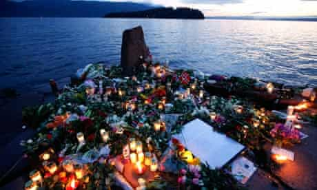Flowers and candles at a temporary memorial on Utoya island