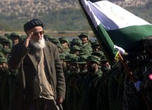 President Rabbani: 2001: President Burnahuddin Rabbani salutes the Afghan flag