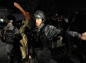 President Rabbani: 2011: An Afghan policeman keeps journalists away from Rabbani's house