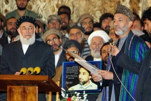 President Rabbani: 2001: Afghanistan's leader Hamid Karzai (R) holding a doctorate degree