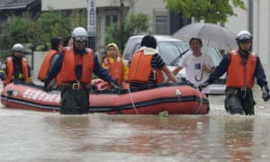 A family is rescued from floodwaters caused by typhoon Roke as it approaches Japan