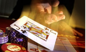 Cards being dealt at a gambling table